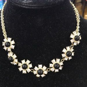 Gold necklace with flowers
